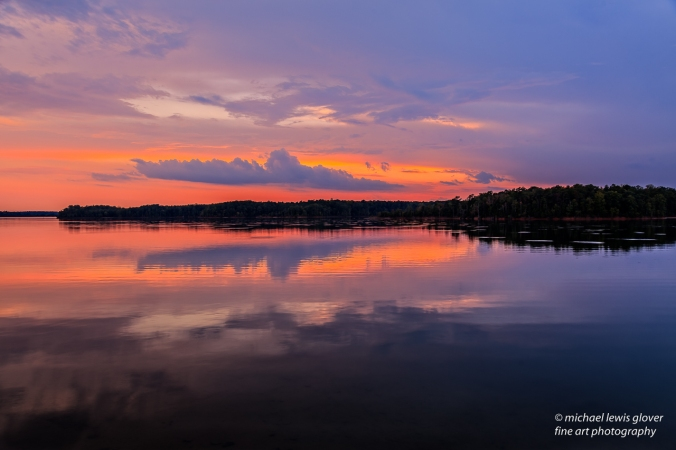 A beautiful sunset reflects upon the water in South Carolina at Calhoun Falls State Park.